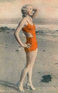 postcard-chicago-exhibit-supply-company-arcade-card-woman-on-beach-profile-hand-on-head-1930s