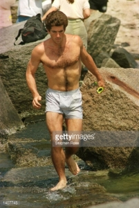 Totally gratuitous and off-topic photo of John F. Kennedy Jr. on the beach just because he was the best